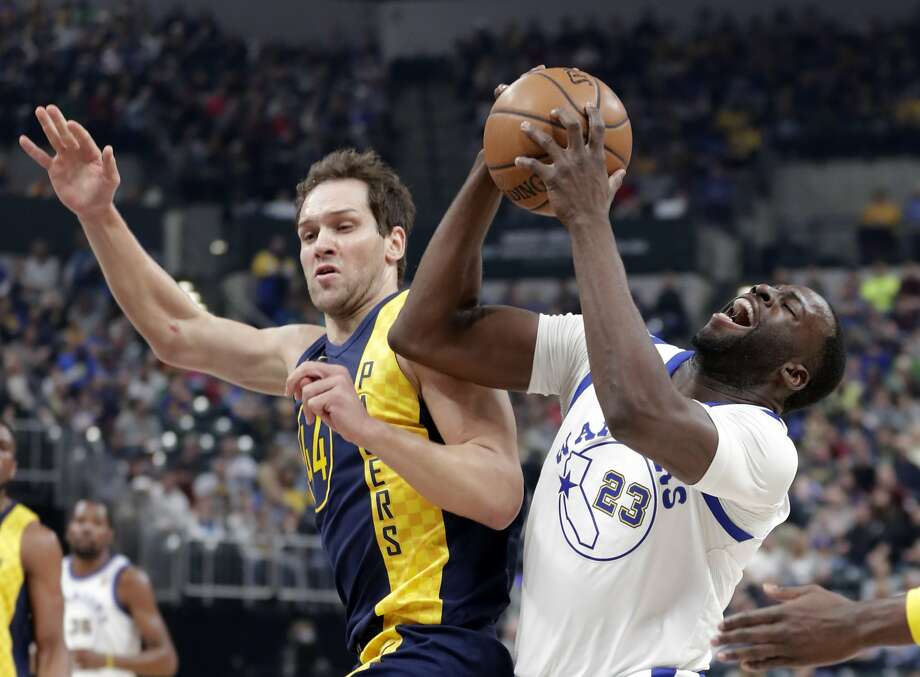 Golden State Warriors forward Draymond Green (23) is fouled by Indiana Pacers forward Bojan Bogdanovic (44) during the first half of an NBA basketball game in Indianapolis, Thursday, April 5, 2018. (AP Photo/Michael Conroy) Photo: Michael Conroy / Associated Press