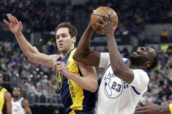 Golden State Warriors forward Draymond Green (23) is fouled by Indiana Pacers forward Bojan Bogdanovic (44) during the first half of an NBA basketball game in Indianapolis, Thursday, April 5, 2018. (AP Photo/Michael Conroy)