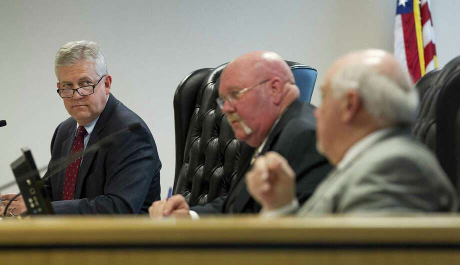Montgomery County Judge Craig Doyal, listens beisde Precinct 2 Commissioner Charlie Riley as Precinct 1 Commissioner Mike Meador debate lowering the water level of Lake Conroe during a Montgomery County Commissioners Court meeting at the Alan B. Sadler Commissioners Court Building, Tuesday, Feb. 27, 2018, in Conroe. Photo: Jason Fochtman, Staff Photographer / Houston Chronicle / © 2018 Houston Chronicle
