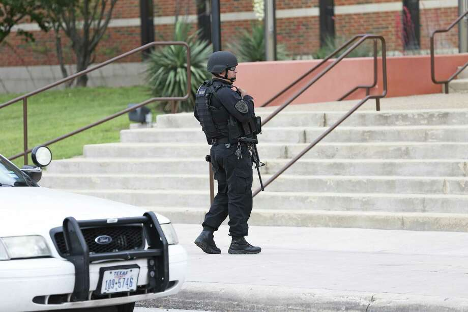 Armed law enforcement officials surround the building Thursday afternoon as Bexar County Sheriff Javier Salazar makes a statement about a foiled escape attempt. Photo: Tom Reel /San Antonio Express-News / 2017 415916Z.1 ANTONIO EXPRESS-NEWS