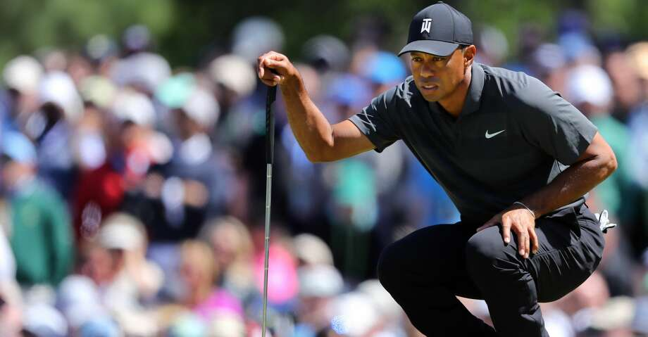 Tiger Woods lines up his putt on the 7th green during the first round of the Masters at Augusta National Golf Club on Thursday, April 5, 2018, in Augusta, Ga. (Curtis Compton/Atlanta Journal Constitution/TNS) Photo: Curtis Compton/TNS