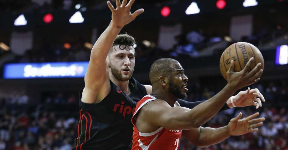 Houston Rockets guard Chris Paul (3) lays up the ball past Portland Trail Blazers center Jusuf Nurkic (27) as the Houston Rockets take on the Portland Trail Blazers at the Toyota Center Thursday, April 5, 2018 in Houston. (Michael Ciaglo / Houston Chronicle) Photo: Michael Ciaglo/Houston Chronicle