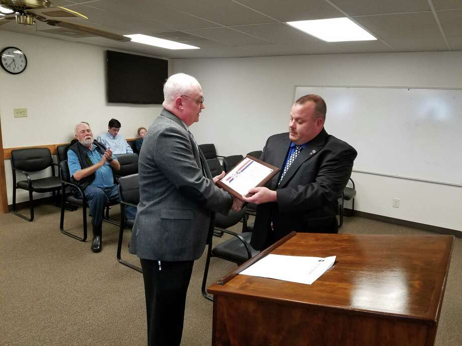 Willis Police Chief James Nowak presented  Detective Sergeant Kevin Rooney with the National Police Hall of Fame Criminal Investigations Award at the March City Council Meeting for his outstanding work in solving and closing the cold case murder of Joe Hightower. Photo: Willis PD