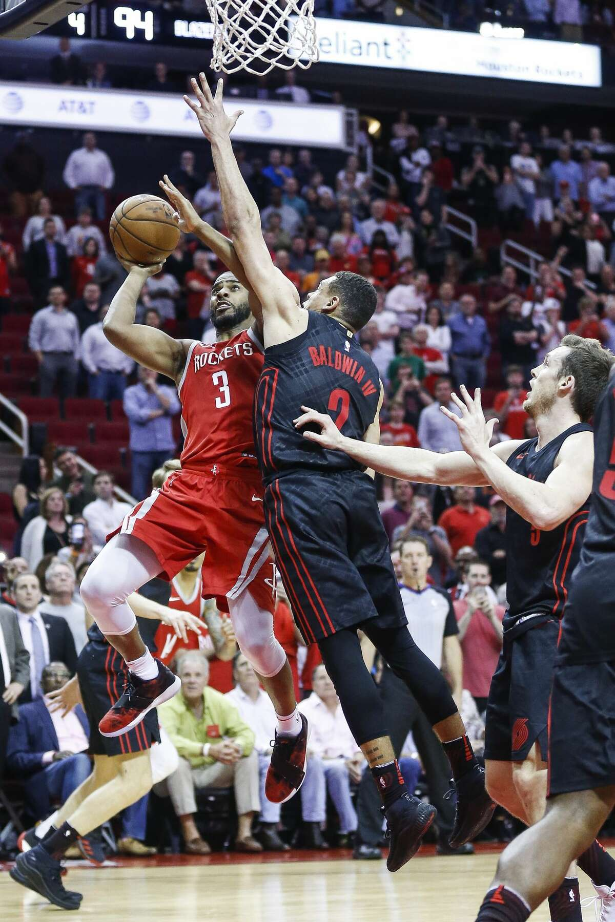 Houston Rockets guard Chris Paul (3) hits the game winning shot over Portland Trail Blazers guard Wade Baldwin IV (2) with seconds left as the Houston Rockets beat the Portland Trail Blazers 96-94 at the Toyota Center Thursday, April 5, 2018 in Houston. (Michael Ciaglo / Houston Chronicle)