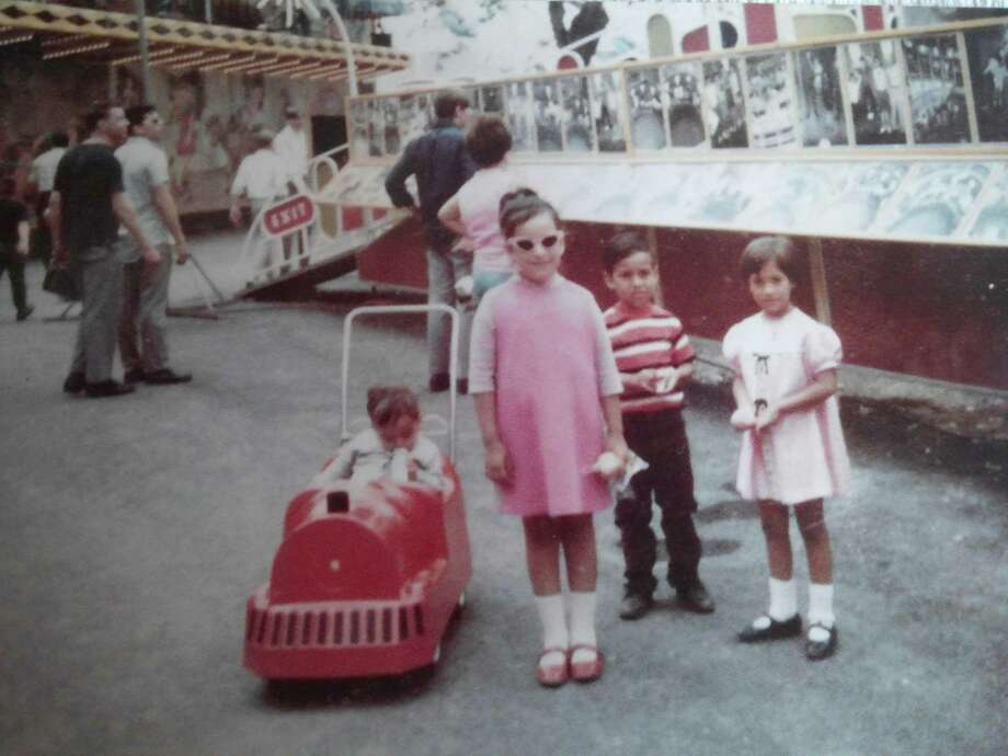 Betty Ramirez stands with members of her family at HemisFair '68, where sheenjoyed the rides and ate her fill of hot dogs. Photo: Photo Courtesy Of Betty Ramirez