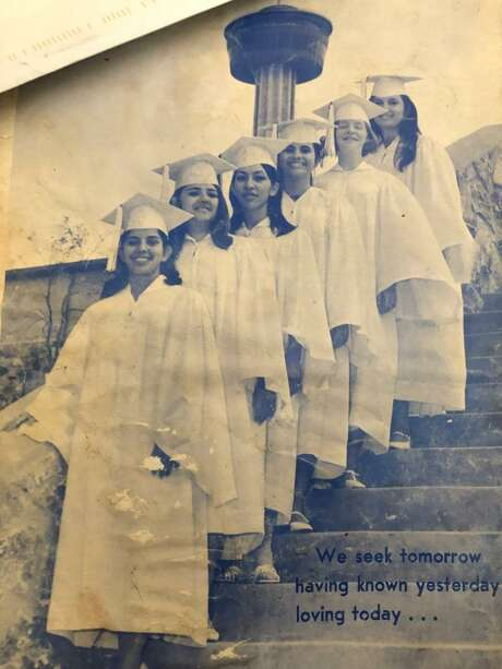 With the Tower of the Americas in the background, Patricia Moss, fourth in line, standswith fellow graduates from St. Francis Academy, a Catholic school that no longer exists. She is centered between Betsy Ornelas Aguirre, Beverly Sosa andMargie Gonzales,in the front, and Paula Kentner Kaspar and Sally Ortiz Azrakan in the back. The teens, from the class of '68, gathered for photos before the World's Fair opened. Photo: Photos Courtesy Of Patricia Moss