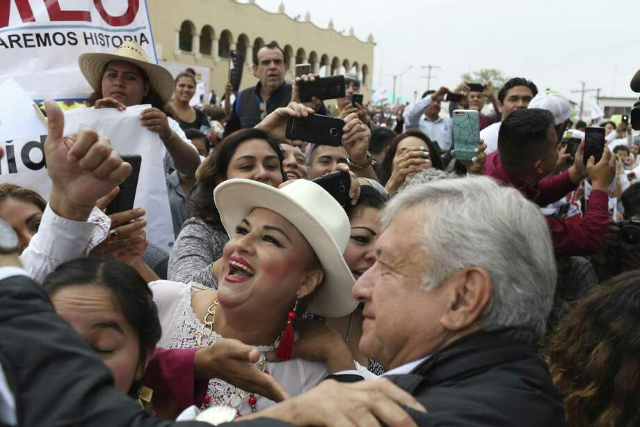 Mexican presidential candidate Andres Manuel Lopez Obrador takes a photograph with a supporter during a campaign stop at the Esplanada Independencia in Nuevo Laredo, Mexico, Thursday, April 5, 2018. Lopez Obrador was on a tour of border cities with stops in Reynosa and Matamoros through the weekend. Lopez Obrador, with the National Regeneration Movement, (MORENA), was leading the polls over National Action PartyÕs Ricardo Anaya and Institutional Revolutionary PartyÕs Jose Antonio Meade. The election is scheduled for July 1st. Photo: JERRY LARA / San Antonio Express-News / San Antonio Express-News
