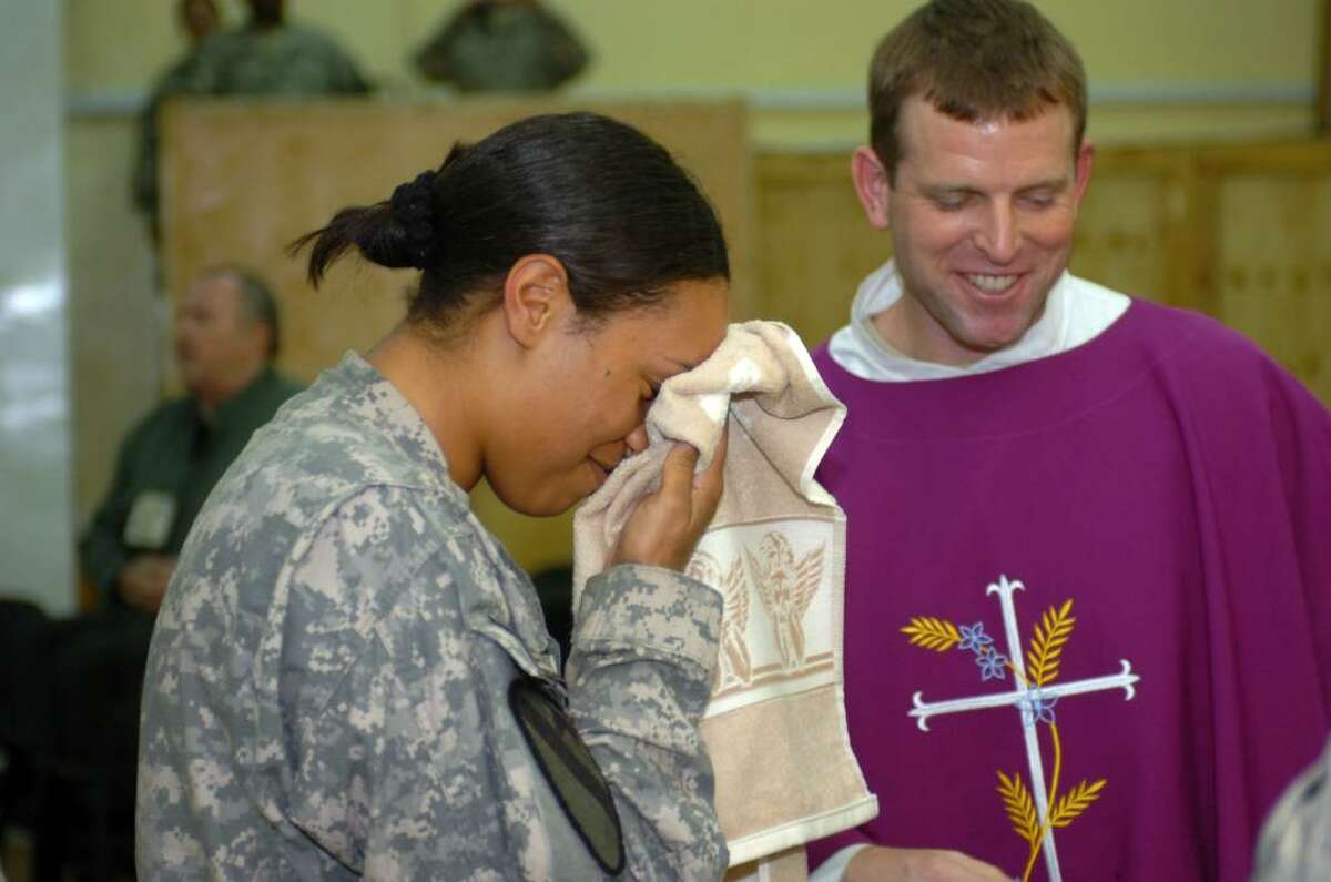 1st Lt. Marjana Mair is confirmed as a Catholic at Tigris River Chapel in a ceremony presided over by Chaplain Maj. Tyson Wood. (submitted photo)