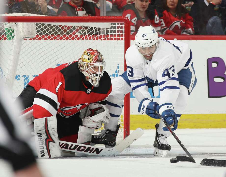 NEWARK, NJ - APRIL 05: Nazem Kadri #43 of the Toronto Maple Leafs tries to control the puck in front of Keith Kinkaid #1 of the New Jersey Devils during the second period at the Prudential Center on April 5, 2018 in Newark, New Jersey.  (Photo by Bruce Bennett/Getty Images) Photo: Bruce Bennett / 2018 Getty Images