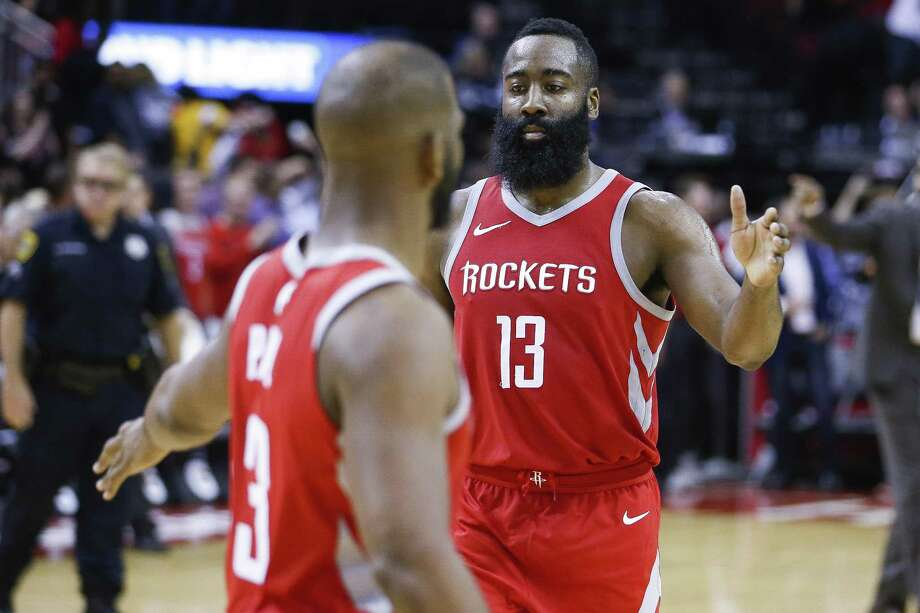 Houston Rockets guard James Harden (13) high fives guard Chris Paul (3) after Paul hit the game winning shot to beat the Portland Trail Blazers 96-94 at the Toyota Center Thursday, April 5, 2018 in Houston. (Michael Ciaglo / Houston Chronicle) Photo: Michael Ciaglo, Houston Chronicle / Houston Chronicle / Michael Ciaglo