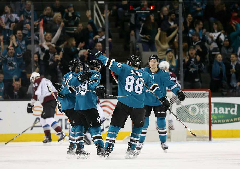SAN JOSE, CA - APRIL 05:  Logan Couture #39 of the San Jose Sharks is congratulated by teammates after he scored a goal in the third period against the Colorado Avalanche at SAP Center on April 5, 2018 in San Jose, California.  (Photo by Ezra Shaw/Getty Images) Photo: Ezra Shaw / Getty Images