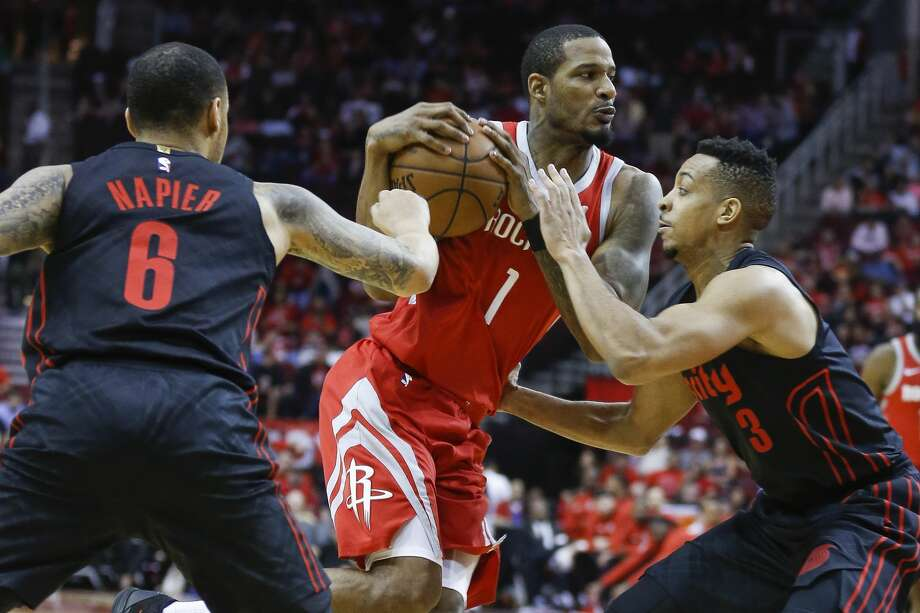 Houston Rockets forward Trevor Ariza (1) drives to the basket through Portland Trail Blazers guard Shabazz Napier (6) and guard CJ McCollum (3) as the Houston Rockets take on the Portland Trail Blazers at the Toyota Center Thursday, April 5, 2018 in Houston. (Michael Ciaglo / Houston Chronicle) Photo: Michael Ciaglo/Houston Chronicle