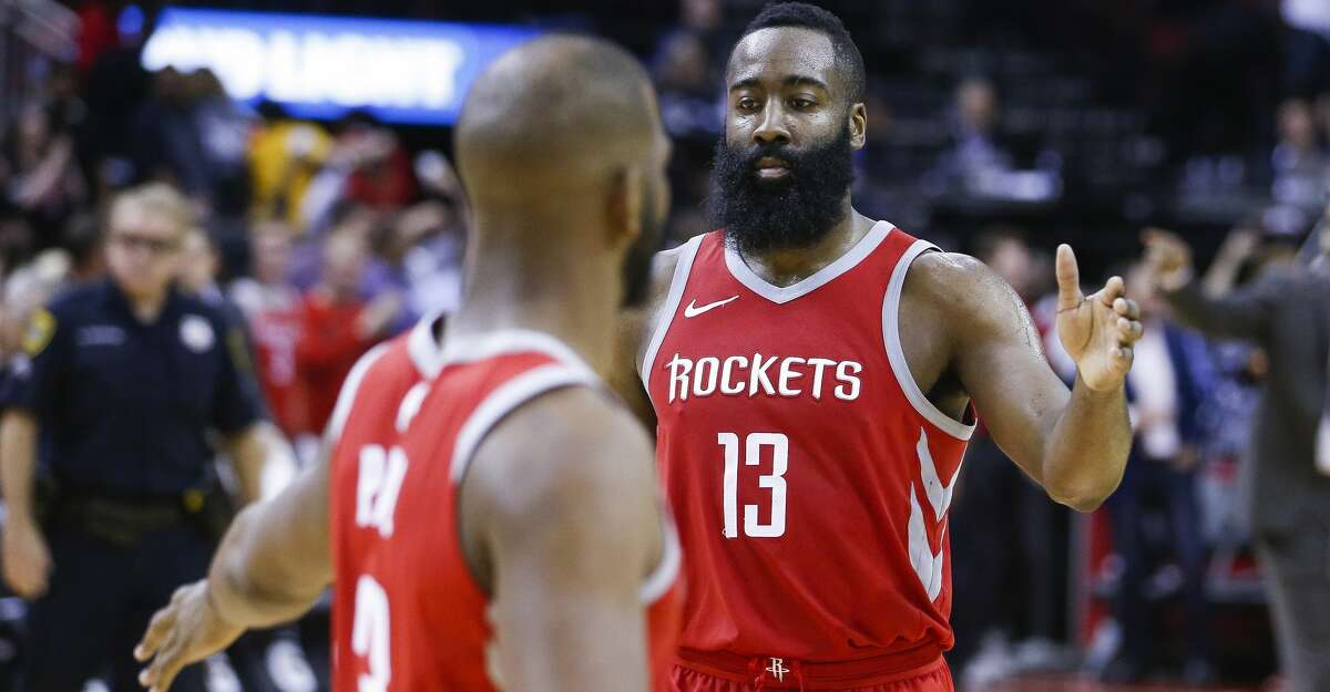 Houston Rockets guard James Harden (13) high fives guard Chris Paul (3) after Paul hit the game winning shot to beat the Portland Trail Blazers 96-94 at the Toyota Center Thursday, April 5, 2018 in Houston. (Michael Ciaglo / Houston Chronicle)