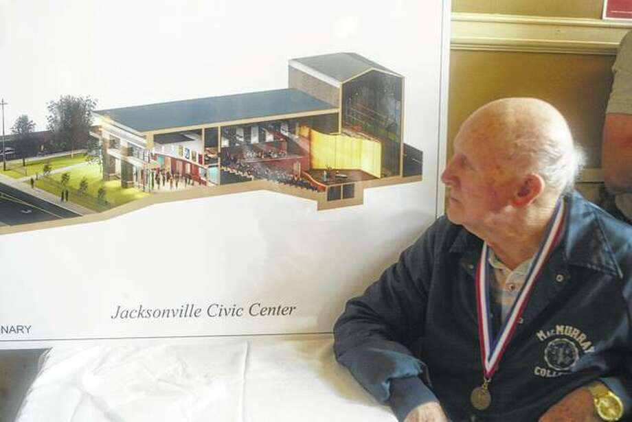 Ed Ecker looks Thursday at an architectual drawing of the planned Jacksonville Civic Center during the Jacksonville Center for the Arts' Thanks a Million party. Photo: Samantha McDaniel-Ogletree | Journal-Courier