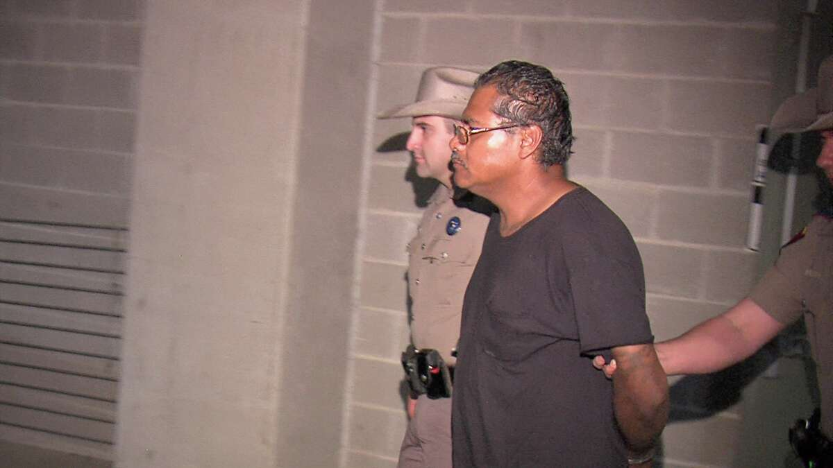 Moises Morales, 44, faces a murder charge in the death of Vincent Fisher, 31. He was booked into the Bexar County Jail early Friday.