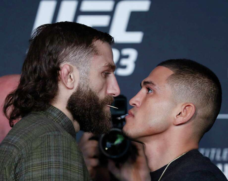 Michael Chiesa, left, poses for photographers with Anthony Pettis on Thursday, April 5, 2018, at UFC 223's media day in New York, to promote a bout scheduled for Saturday. Chiesa's fight status was unclear after he was sent to the hospital with injuries. Photo: Kathy Willens, AP / Copyright 2018 The Associated Press. All rights reserved.