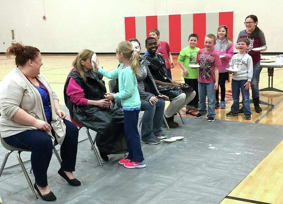 As a way to promote reading, Owendale-Gagetown Elementary students who read for 350 minutes recently received an award. The top three readers in each class received a certificate and the top readers got to put a pie in the face of facility members. (Submitted Photo)