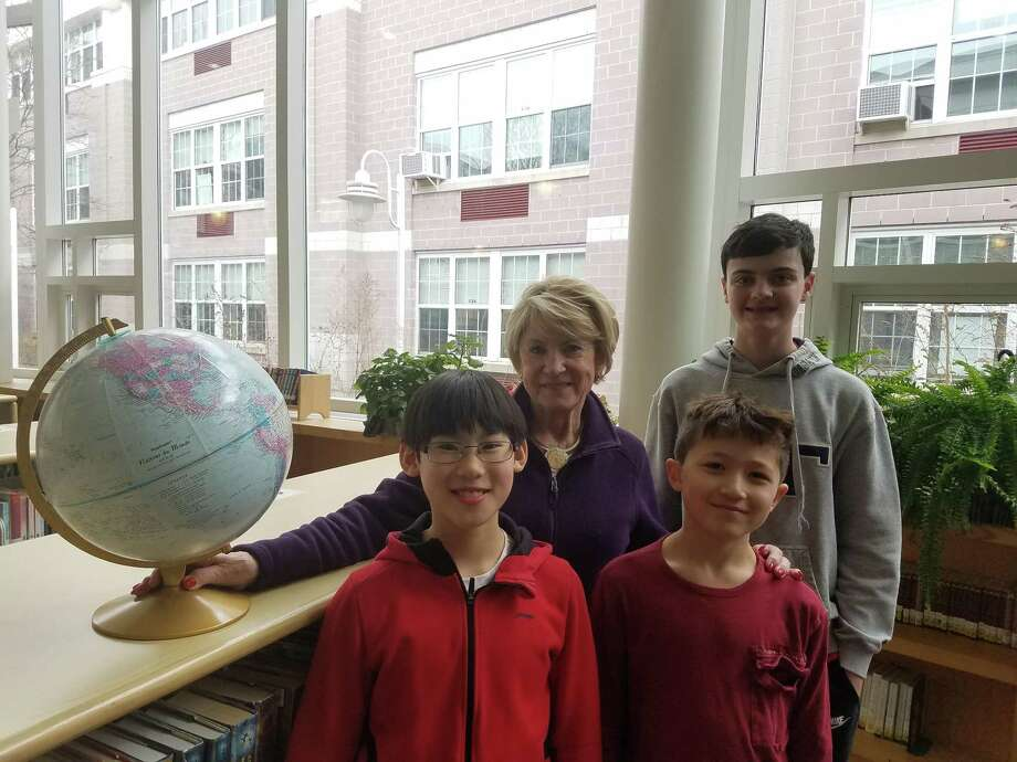 Three Darien students scored in the top 100 in Connecticut for the National Geographic Bee this year. Ox Ridge fourth-grader Frank Hu, Hindley fourth-grader Roman Gagliardi, and MMS eighth-grader James Leone all qualified for the State Bee, which takes place on Friday at Central Connecticut State University in New Britain. The National Geographic Bee is an annual competition organized by the National Geographic Society, designed to inspire and reward students' curiosity about the world. Pictured front, from left are Hu and Gagliardi and, back, Barbara Ivey, National Geographic Bee's Darien district coordinator and coach and Leone. Photo: Darien News / Contributed Photo / Darien News