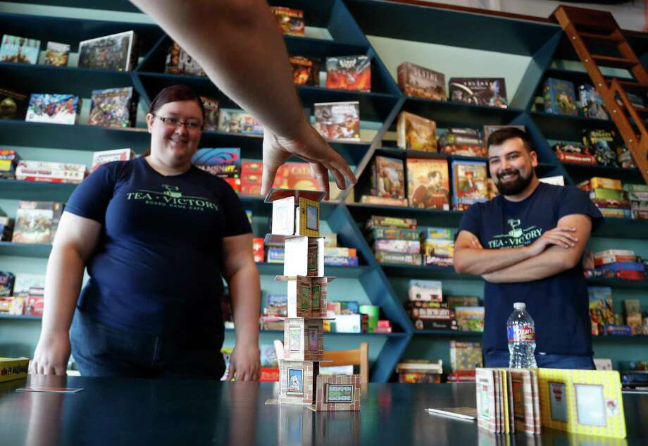 """Game Guides"" Ryan Escontrias and Rachel Rentz play Rhino Hero at the Houston board game cafe, Tea + Victory, 2030 E. TC Jester. The cafe is stocked with more than 500 board games and Game Guides, who are game experts there to help customers select and play games.  Photo: Karen Warren, Houston Chronicle / © 2018 Houston Chronicle"