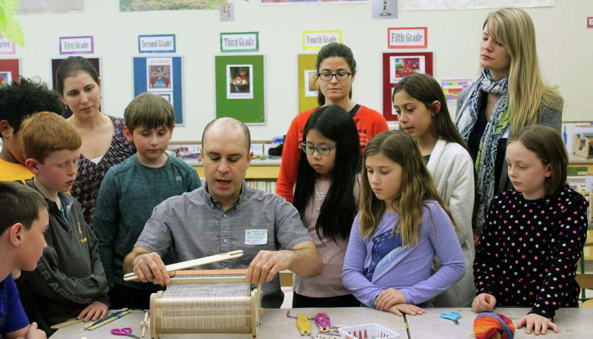 Weaver Ruben Marroquin with McKinley Elementary School students and (from left to right, in back) art teacher Amy Gorruso, artist Liz Squillace and McKinley's Director of Cultural Arts Sally Connolly, at McKinley Elementary School in Fairfield, Conn., April 3, 2018.