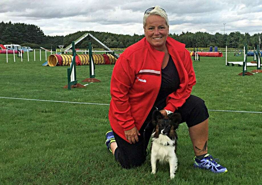 Dog agility competitor Monique Plinck of Deep River and her Papillon Tush will represent the United States at the 2018 IFCS World Agility Championships in Italy. Photo: Contributed Photo
