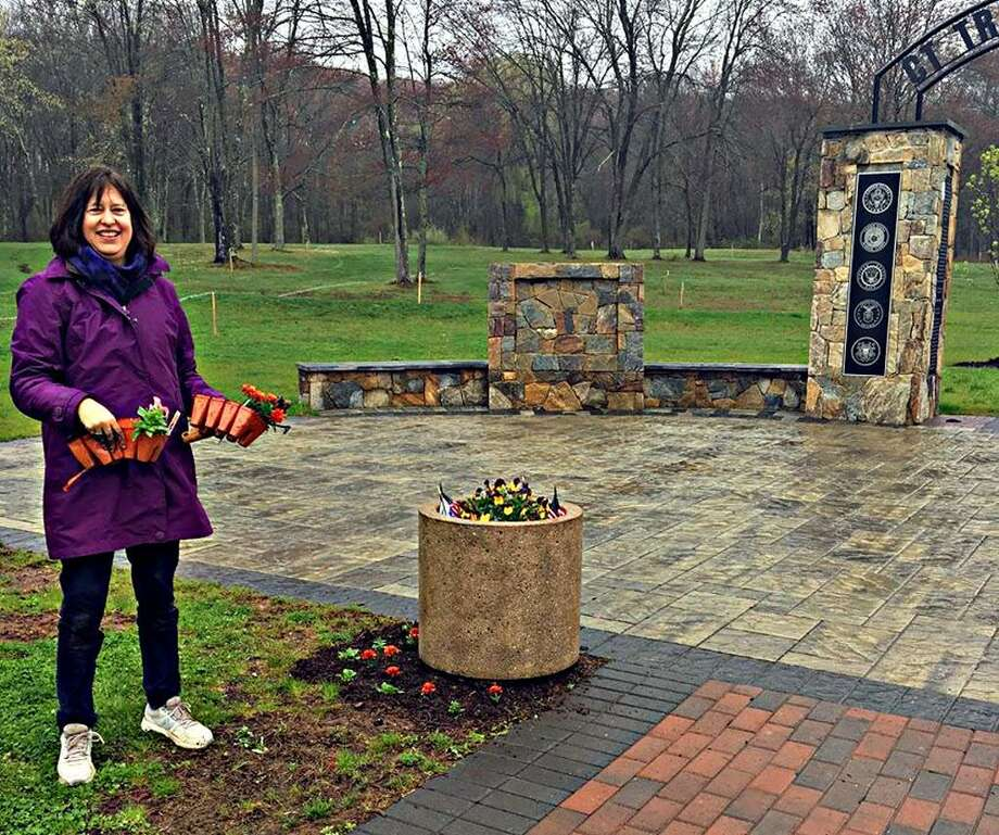 Middlesex United Way member Ann Faust volunteered at last year's Comcast Cares Day at the Connecticut Trees of Honor memorial at Veterans Memorial Park in Middletown. Photo: Contributed Photo
