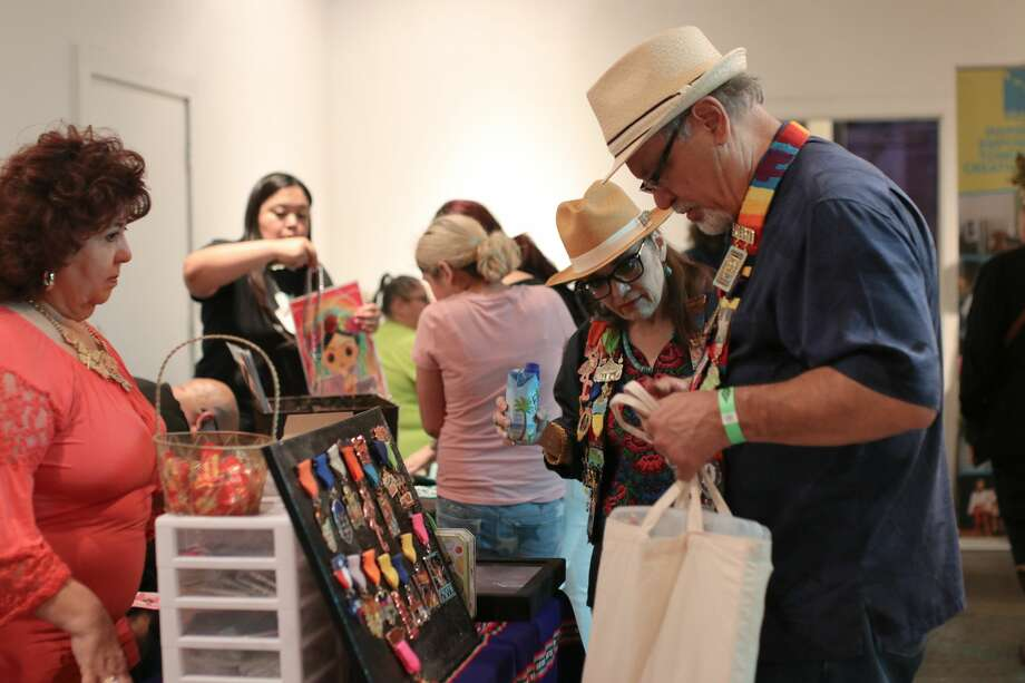 The arts collective over at Brick got a jump on Fiesta madness Thursday night, April 6, 2018, with Fiesta Medal Fest. The event featured vendors selling newly crafted and vintage Fiesta Medals. Photo: Stacey Lovett For MySA