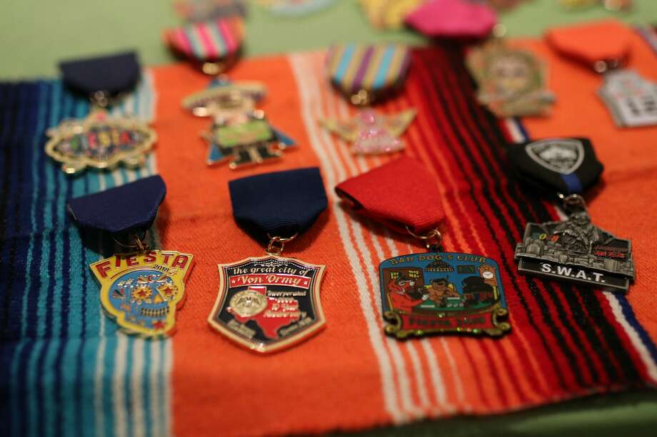 Medals They're like badges of honor.  Photo: Stacey Lovett For MySA
