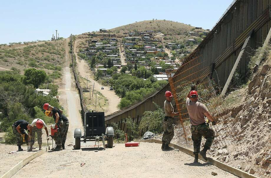 Members of the 200th Red Horse Air National Guard Civil Engineering Squadron from Camp Perry in Ohio work on road construction during the unit's deployment in 2008 to the border in Nogales, Ariz. Photo: Ross D. Franklin / Associated Press 2008