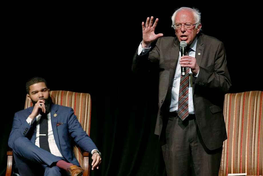 Jackson Mayor Chokwe Antar Lumumba (left) listens as Sen. Bernie Sanders, I-Vt., answers a question during a town hall meeting Wednesday in the Mississippi state capital. Photo: Rogelio V. Solis / Associated Press