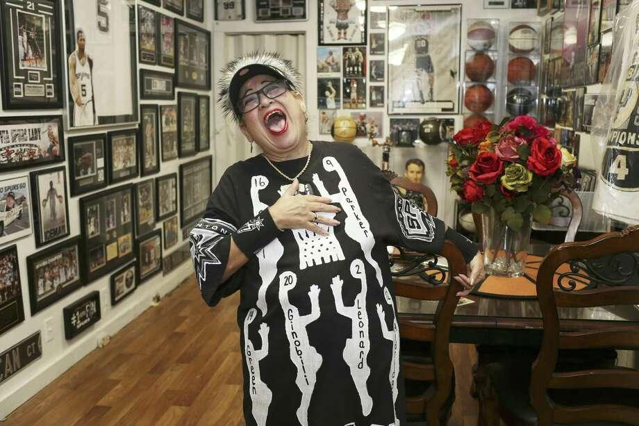 Spurs fan Sovia Lauriano has a house full of Spurs memorabilia. Photo: Jerry Lara /San Antonio Express-News / San Antonio Express-News