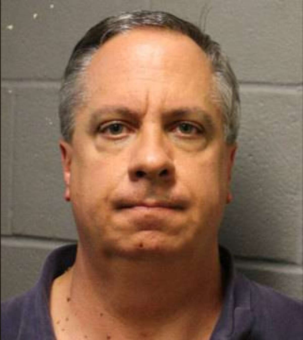A booking photo of Gregory Wayne Lueb, 56, at the Harris County Jail on April 5, 2018. Lueb, a former top ranking employee of the Harris County Treasurer's Office, is charged with felony theft.
