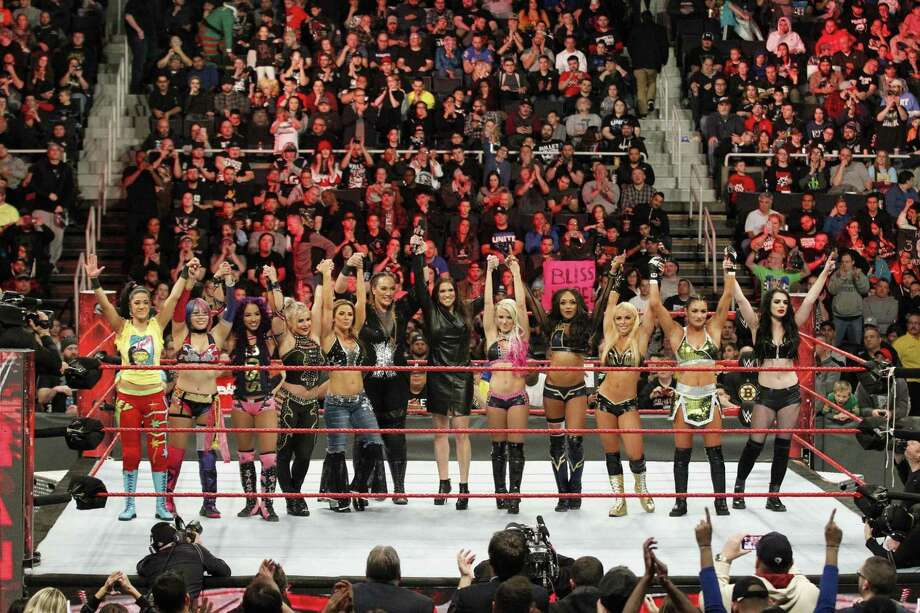 WWE women Superstars join hands during an announcement Dec. 18, 2017 at Dunkin' Donuts Center in Providence, R.I., that the first women's Royal Rumble match would be held the following month in Philadelphia. Photo: Contributed Photo