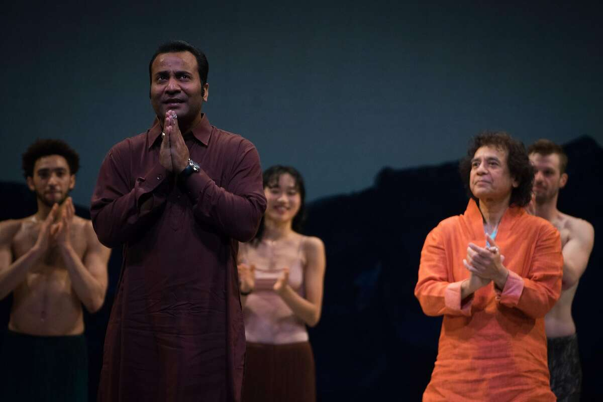 Sabir Khan (left) and Zakir Hussain (right) join dancers on stage after a dress rehearsal for the world premiere of Alonzo King LINES Ballet 35th Anniversary at YBCA Theater in San Francisco, Calif. on Thursday, April 5, 2018.