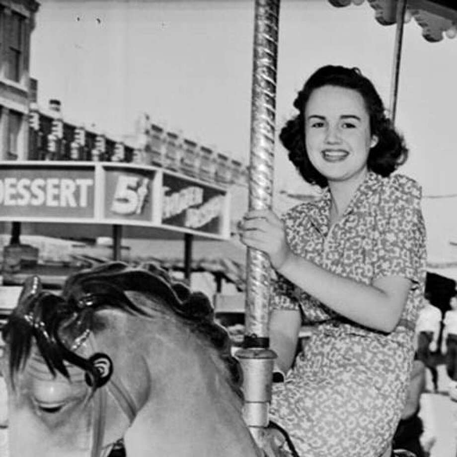Virginia Fitzgerald (left) and Hazel Nell Astin riding carousel horses at Fiesta carnival in 1939. Photo: San Antonio Light Photograph Collection, UTSA Special Collections -- Institute Of Texan Cultures