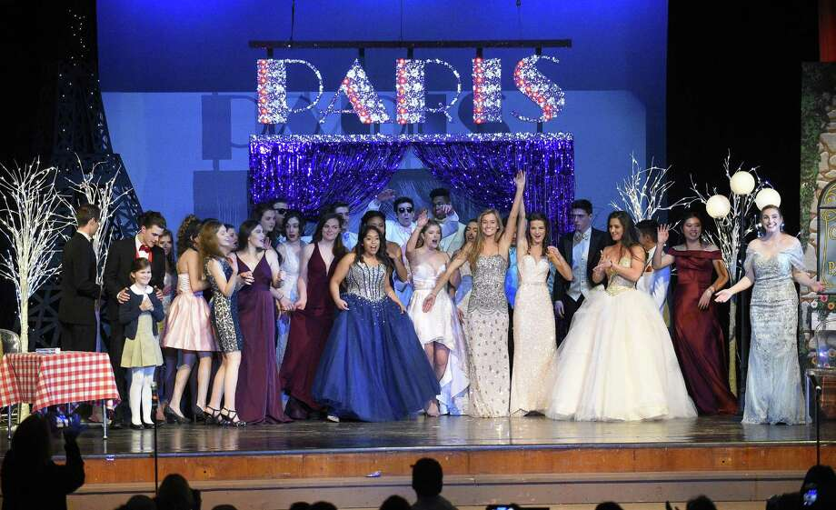 """Senior participants gather on stage for a finale to Trinity Catholic High School """"A Night in Paris"""" Fashion Show on April 4, 2018 in Stamford, Connecticut. Fashion show proceeds benefit the Memorial Scholarship funds for Robert D'Aquila, Kevin Sutton and Cassidy Geary. Photo: Matthew Brown / Hearst Connecticut Media / Stamford Advocate"""