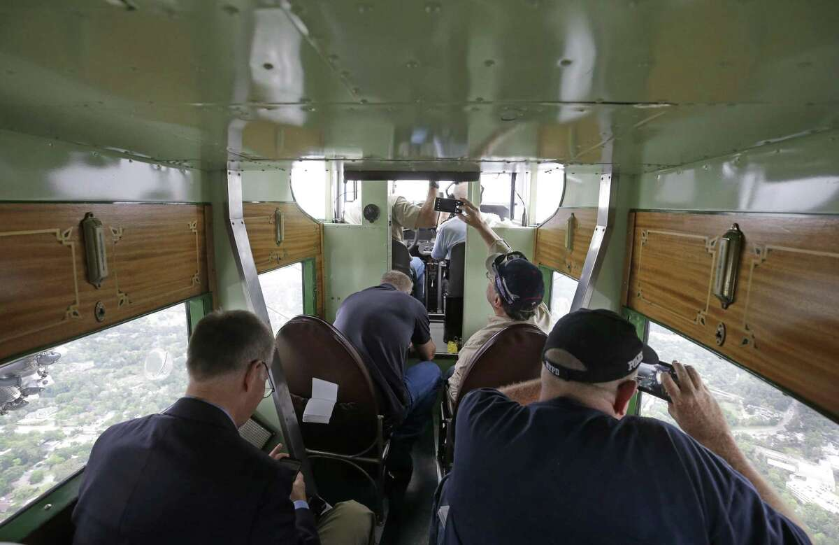 Passengers look out during a flight on the Experimental Aircraft Association's 1929 Ford Tri-Motor Thursday, April 5, 2018, in Houston. The EAA is selling tickets to the public for short flights at West Houston Airport from Thursday through Sunday. From 1926 through 1933, Ford Motor Company built 199 Tri-Motors. The EAA's model 4-AT-E was the 146th off Ford's innovative assembly line and first flew on August 21, 1929. It was sold to Pitcairn Aviation's passenger division, Eastern Air Transport, whose paint scheme is replicated on EAA's Tri-Motor. ( Melissa Phillip / Houston Chronicle )
