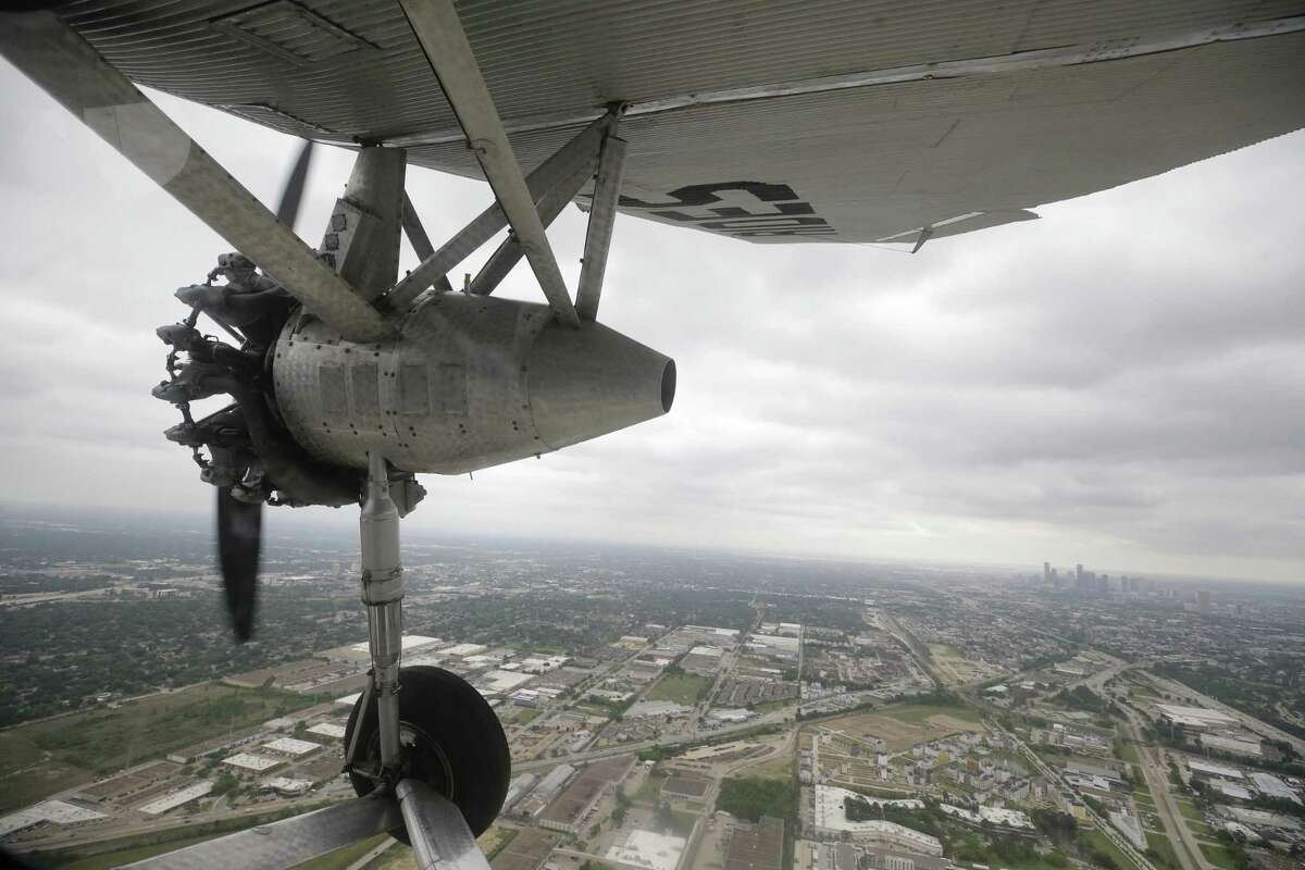 A view from the Experimental Aircraft Association's 1929 Ford Tri-Motor is shown in flight Thursday, April 5, 2018, in Houston. The EAA is selling tickets to the public for short flights at West Houston Airport from Thursday through Sunday. From 1926 through 1933, Ford Motor Company built 199 Tri-Motors. The EAAs model 4-AT-E was the 146th off Ford's innovative assembly line and first flew on August 21, 1929. It was sold to Pitcairn Aviation's passenger division, Eastern Air Transport, whose paint scheme is replicated on EAA's Tri-Motor. ( Melissa Phillip / Houston Chronicle )