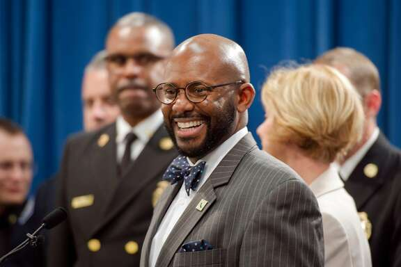 Assemblymember Mike Gipson, D-Carson, center, smiles before a press conference on AB 1795 at the state Capitol in Sacramento, Calif. on Wednesday, April 4, 2018. Gipson introduced a law that would enact a moratorium on arrests for minor offenses in foster-care facilities. He plans to introduce a $7.5 million budget proposal to better train facility staff and police, and fund diversion programs to keep foster youth out of the criminal justice system.