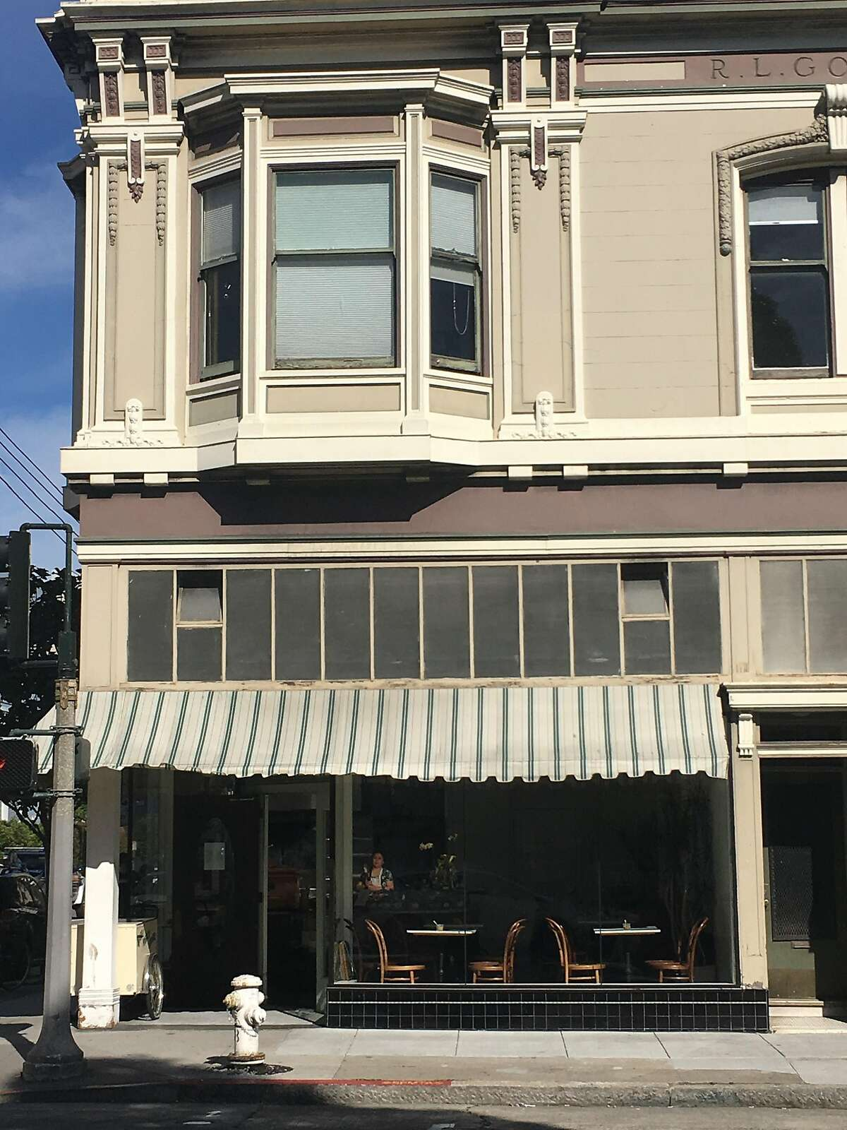 The exterior of 20th Century Cafe, after owner Michelle Polzine repaired her renovated windows following a February 3 car crash.