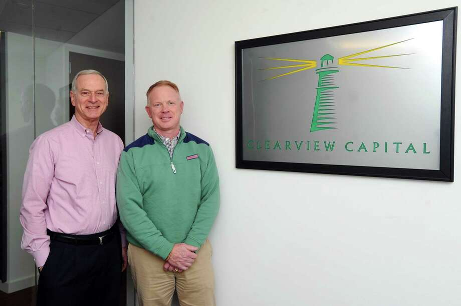 Clearview Capital founders and managing partners James Andersen, right, and Cal Neider pose for a photo inside Clearview's offices at 1010 Washington Blvd., in downtown Stamford, Conn., on Feb. 8, 2018. Photo: Michael Cummo / Hearst Connecticut Media / Stamford Advocate