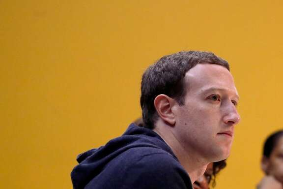 "FILE- In this Nov. 9, 2017, file photo, Facebook CEO Mark Zuckerberg meets with a group of entrepreneurs and innovators during a round-table discussion at Cortex Innovation Community technology hub in St. Louis. Facebook said Wednesday, April 5, 2018, that it has shut down a feature that let people search for Facebook users if they had their phone number or email address. In a call with reporters on Wednesday, Zuckerberg said the company had tried ""rate limiting"" the searches. This restricted how many searches someone can conduct at one time, based on their device's IP address. But Zuckerberg said this was circumvented by bad actors cycling through multiple IP addresses. (AP Photo/Jeff Roberson, File)"