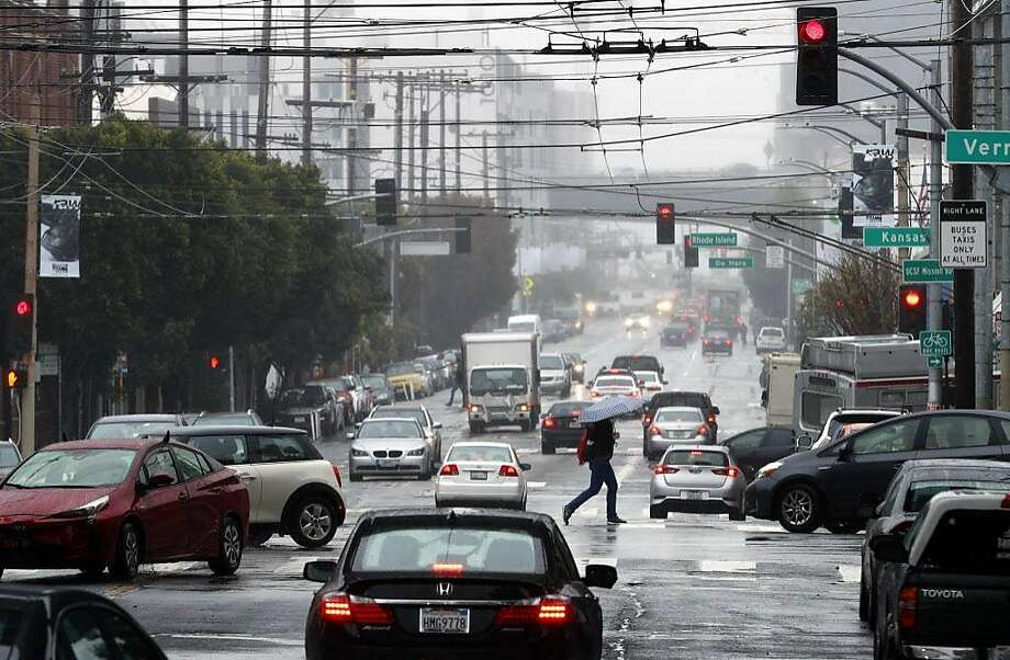 17th st. at Vermont as the rain continues to fall, on Fri. April. 6, 2018  in San Francisco, Calif. Photo: Michael Macor / The Chronicle