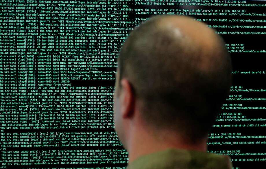 Cyberattacks by Russia and other foreign adversaries appear on the rise, according to recent government and private security reports. Photo: Michel Spingler, STR / Associated Press / Michel Spingler