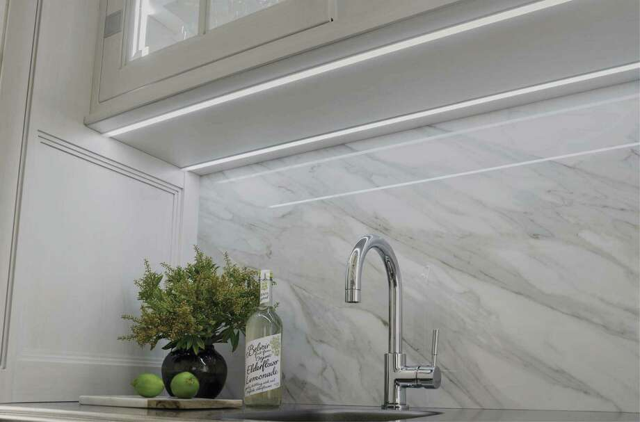 Integrated undercabinet lighting illuminates countertops and backsplashes while reducing shadows from overhead lighting.