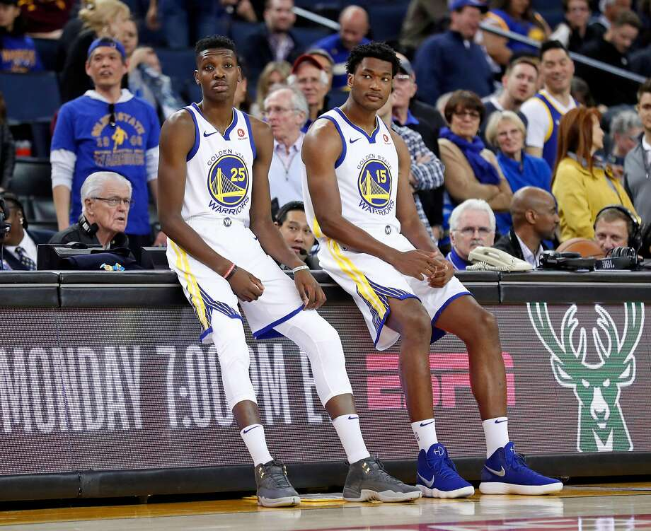 Golden State Warriors' Chris Boucher and Damian Jones wait to enter the game in 4th quarter during Warriors' 117-106 win over Los Angeles Lakers in NBA game at Oracle Arena in Oakland, Calif., on Wednesday, March 14, 2018. Photo: Scott Strazzante / The Chronicle
