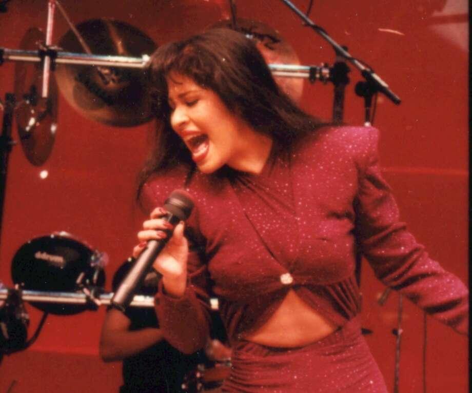 Tejano singer Selena performs in 1995 at the Astrodome in Houston. Photo: John Everett / Houston Chronicle 1995