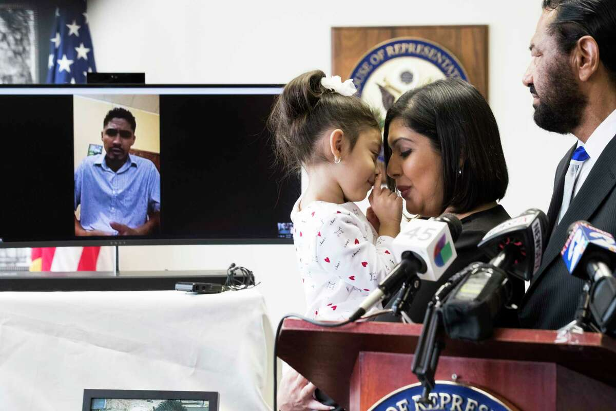Carmen Escobar, 3, and her mother Rose Escobar share a moment while Rose's husband Jose Escobar speaks to the press live from El Salvador during an announcement by Congressman Al Green (TX-09) on which the congressman announced a plan to introduce The Reentry and Reunification Act of 2018, Friday, April 6, 2018, in Houston.