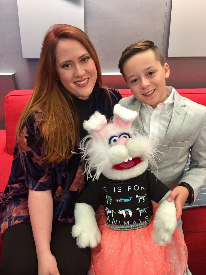 Lara Jennings, counselor with the SIUE Upward Bound Math and Science program, poses with her ventriloquist son, Rain, and his self-made puppet, Tomato. Photo: For The Intelligencer