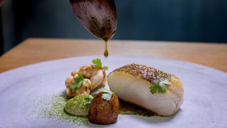 True cod, roasted hen juices emulsified with young garlic, and almond panade at Commis in Oakland, one of the Bay Area's Michelin-star restaurants. Photo: John Storey, Special To The Chronicle